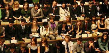 Young people being schooled in parliamentary debate